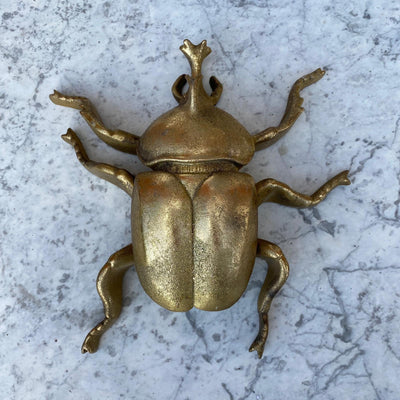 Gold beetle ornament