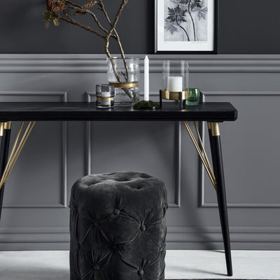 Black wooden console table with gold detailing and black wooden legs