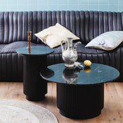 Black marble coffee table with a wide pedestal black base