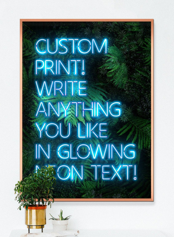 Blue custom neon LED sign art print with a green leaves background
