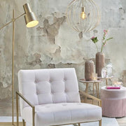 Brass floor lamp with a cantilever arm, directional lamp shade and rectangular base