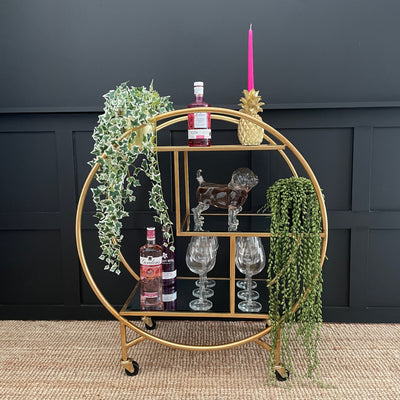 Circular gold drinks trolley with three staggered mirror shelves