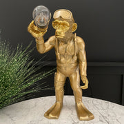 Monkey in a scuba diver suit table lamp holding a bulb
