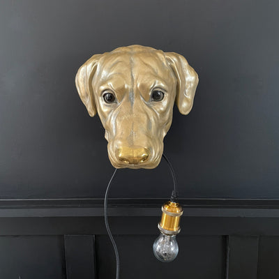 Gold dog wall lamp with a bulb in it's mouth