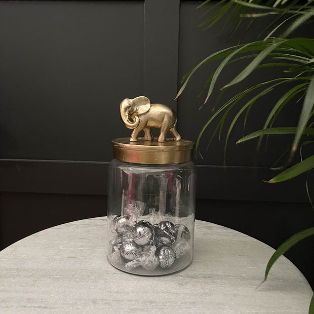 Glass elephant storage jar with a gold lid