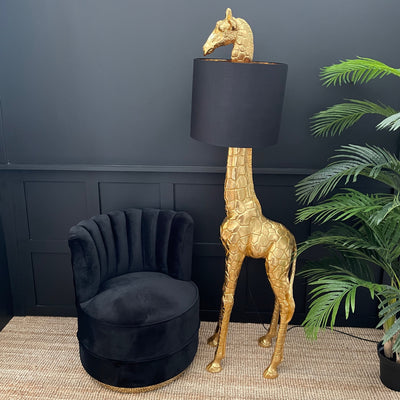 Large gold giraffe floor lamp with a black lampshade
