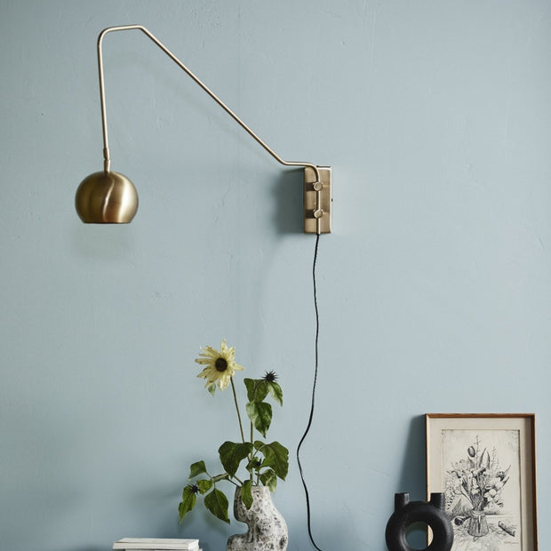 Gold globe wall light