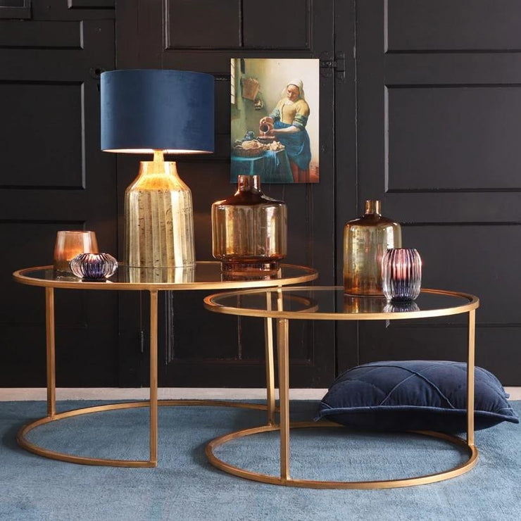 Set of two nesting gold hooped design curved coffee tables with glass shelves