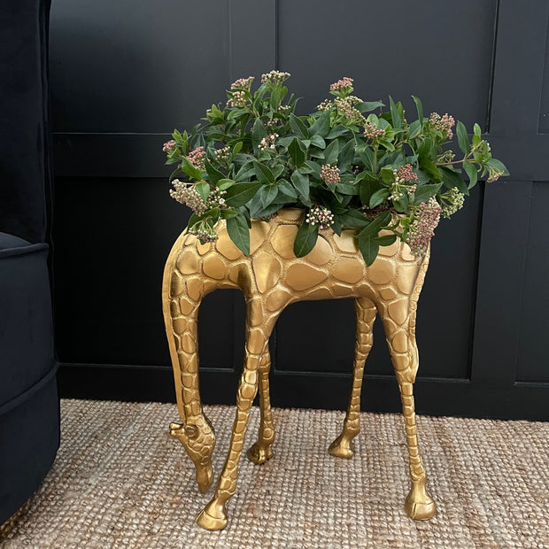 Gold giraffe standing planter with it's neck down
