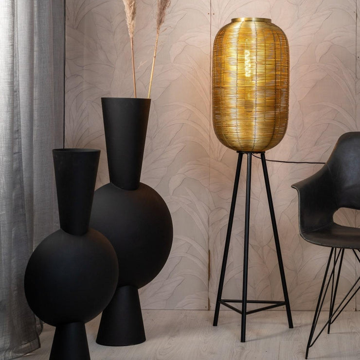 Gold woven tripod floor lamp with black legs