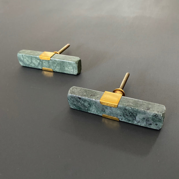 Green marble rectangular door knobs with gold detailing