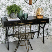 Sleek metal framed black hallway table with three drawers