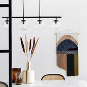 Black long linear pendant light with four glass globes