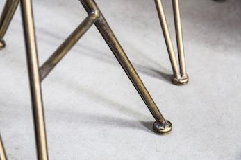 Metal legs and feet on brass metal dining chair