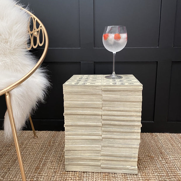 Stack of 100 dollar notes side table