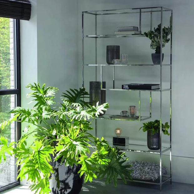 Freestanding nickel silver shelving unit with staggered geometric clear glass shelves