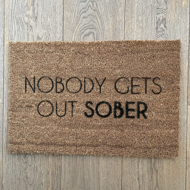 Nobody gets out sober doormat