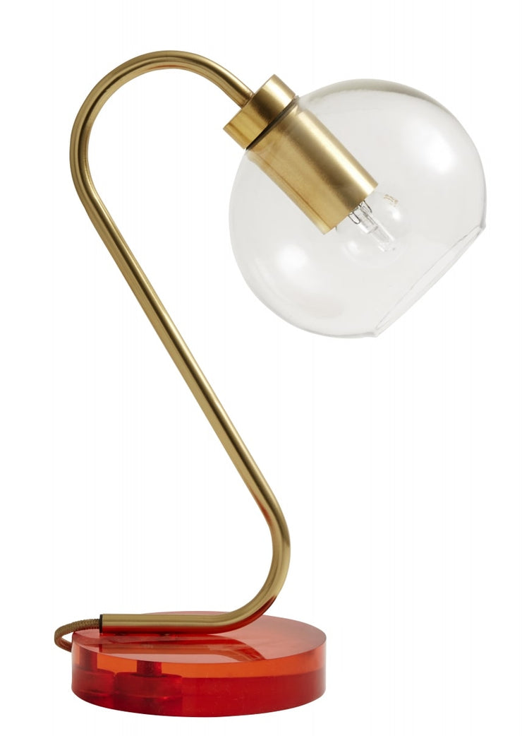 Clear glass globe brass table lamp with an orange base