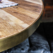 Gold oval wooden panel dining table