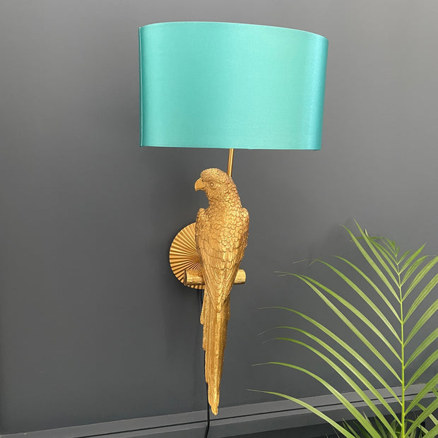 Gold parrot wall light with an aqua blue shade