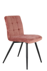 Pink curved back stitched velvet dining chair with black wooden legs