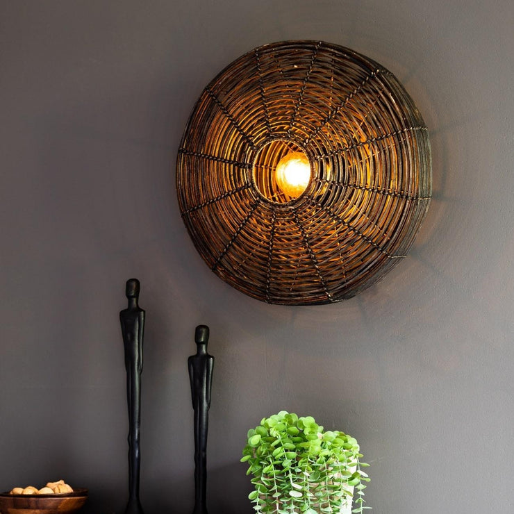 Black circular rattan wall light