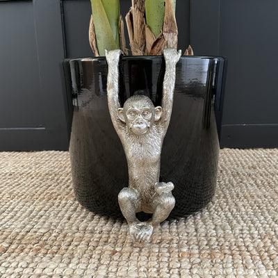 Silver monkey plant pot hanger with it's arms up