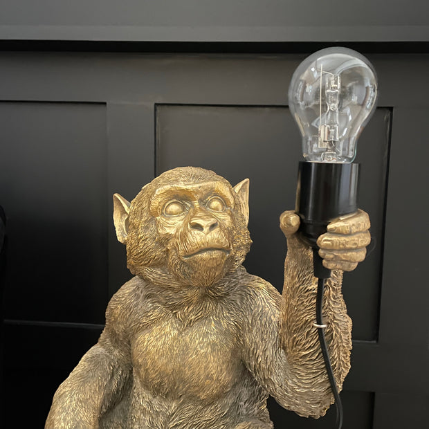 Gold sitting monkey lamp