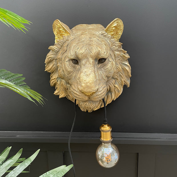 Gold tiger head wall lamp with a bulb in it's mouth