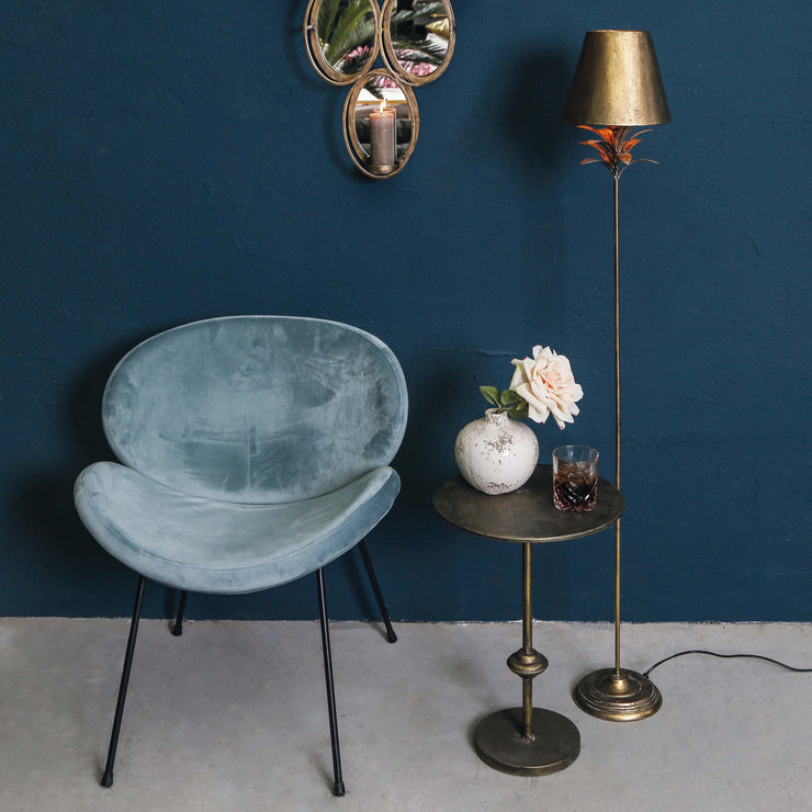 Velvet teal dining chairs with black legs