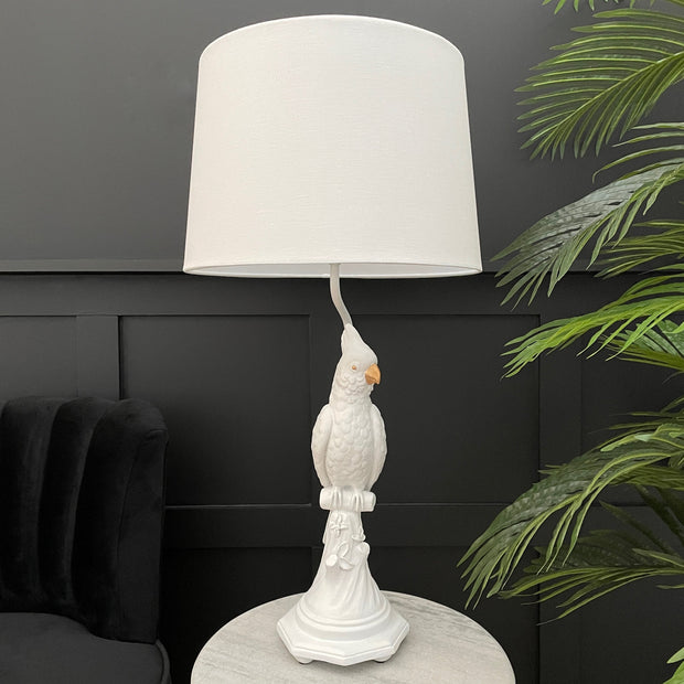 White parrot table lamp with a white lamp shade