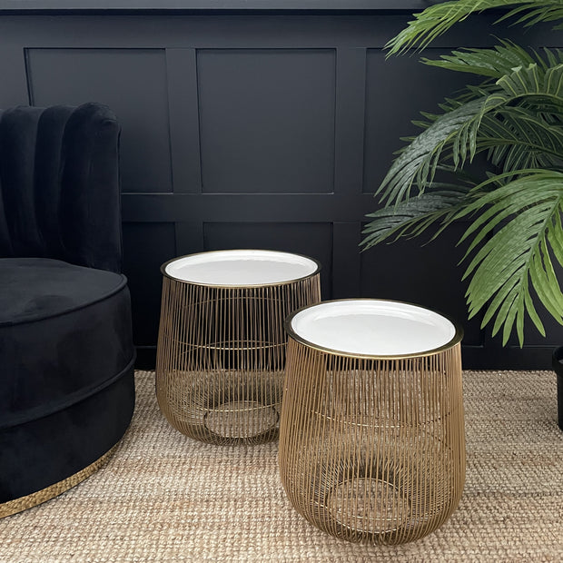 White round topped set of two curvaceous gold metallic wire based side tables