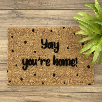 Spotty doormat with yay you're home on the front
