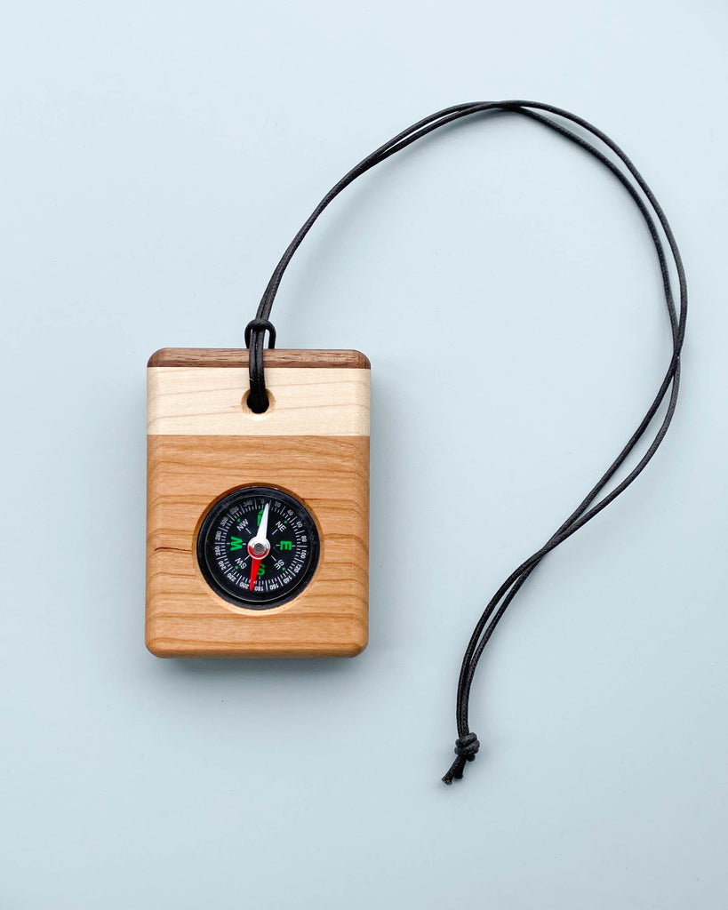 "Wooden Compass <br/> <font size=""2.7"">Gives 2 meals</font>"