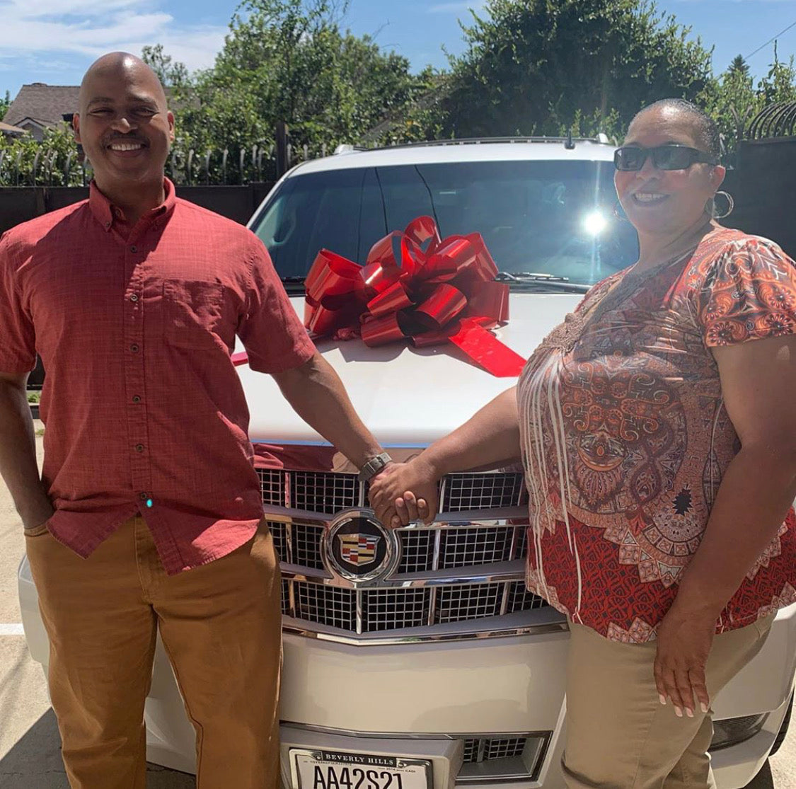 Happy couple loves their new Cadillac Escalade!