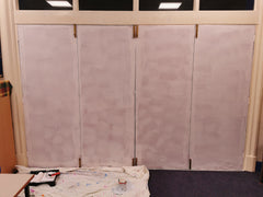 Primed doors ready for painting