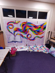 Large colourful rainbow wall mural work in progress painted by Anna Hughes, Anya's  Studio