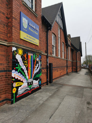 Rainbow colourful exterior wall mural at asfordby hill school by Anna Hughes of Anya's Studio