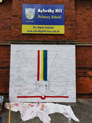 Beginning a colourful mural at a school by Anna Hughes, Anya's Studio