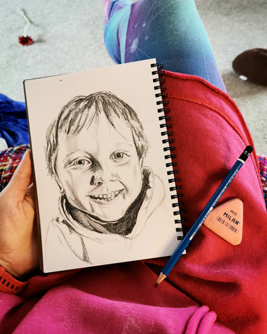Pencil drawing child's portrait by Anna Hughes, Anya's Studio