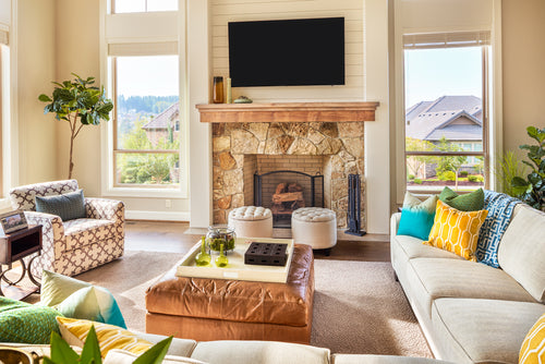 Beautiful Furnished Living Room Interior in New Luxury Home with Fireplace and Television