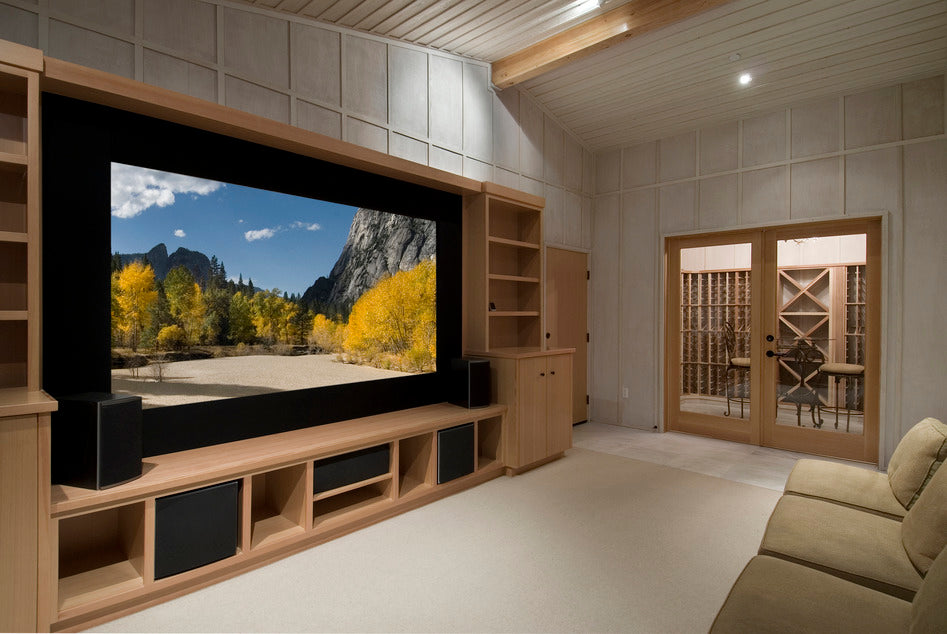 Home theater with wine tasting room, big screen, wood cabinets, photo on screen is from yosemite