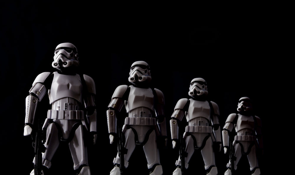 four storm troopers side by side