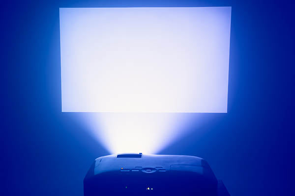 projector in action with illuminated screen