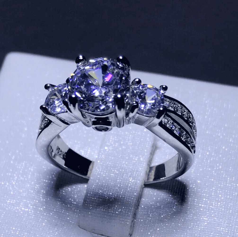 Exquisite 3 Stone Pave Ring