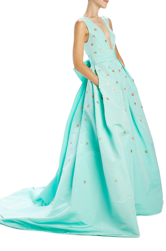 Sleeveless deep v-neck ball gown with bow