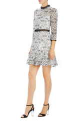 black and white lace cocktail dress with long sleeves