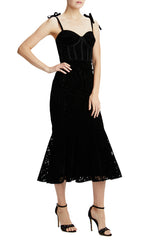Black velvet fitted cocktail dress with tie straps