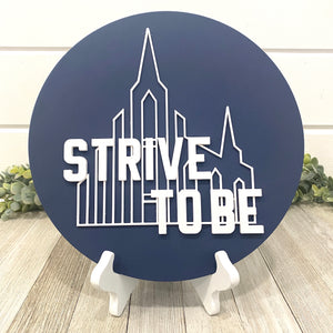 "Strive To Be Wall Plaque 10"" Circle"
