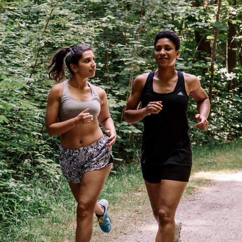 2 people jogging on a trail